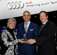 Mark Del Rosso, executive vice president and COO Audi America accepts Most Earth Aware SUV of the Year Award from Mike Martini, president Bridgestone OE America and Courtney Caldwell, editor in chief, Road & Travel Magazine