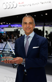 Mark Del Rosso, Audi EVP & COO accepts award for Audi Q5 - Most Earth Aware SUV of the Year for 2014